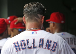 Texas Rangers starting pitcher Derek Holland (45) sports a unique hair cut as he prepares to pitch in the first inning of the Seattle Mariners vs. the Texas Rangers major league baseball game at Globe Life Park in Arlington on Wednesday, August 19, 2015. (Louis DeLuca/The Dallas Morning News)