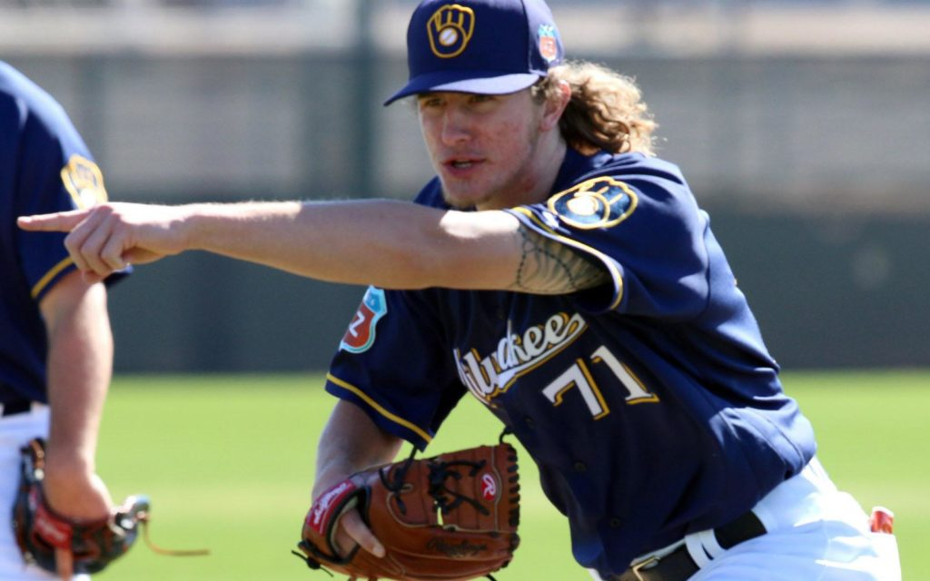 Milwaukee Brewers non-roster invitee Josh Hader, points to help his catcher field a wild pitch, Wednesday, February 24, 2016, in Phoenix. Arizona.(Photo/Roy Dabner) ORG XMIT: RD037